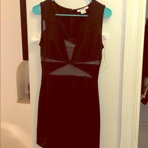 Glamorous black mini dress with cut outs